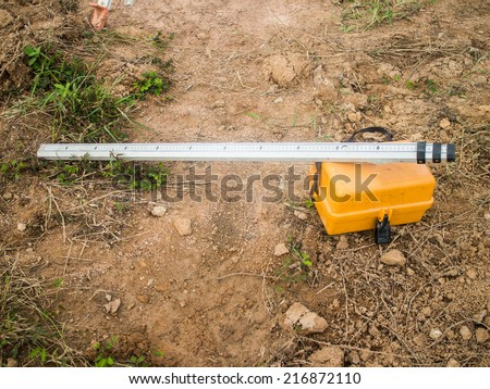 Surveying measuring equipment level theodolite on tripod at construction site - stock photo