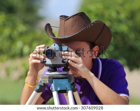 Surveyor engineer on construction site - stock photo