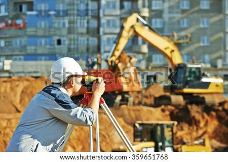 Surveyor working with theodolite equipment - stock photo
