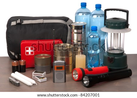 Survival kit on a wooden table - stock photo