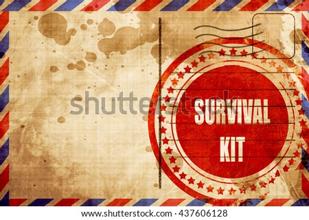 Survival kit sign, red grunge stamp on an airmail background - stock photo
