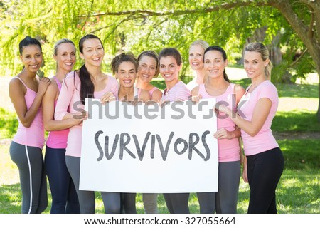 Survivors in pink against smiling women in pink for breast cancer awareness - stock photo