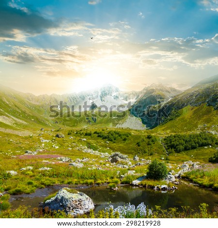 suset over a mountain valley - stock photo