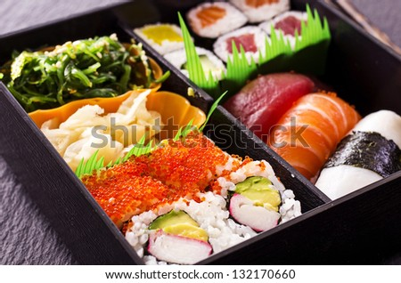 sushi and rolls in bento box - stock photo