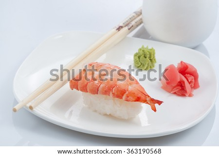Sushi and rolls in the set on a decorative the tray