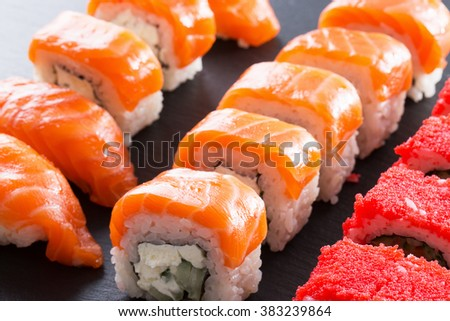 sushi and rolls on a slate table
