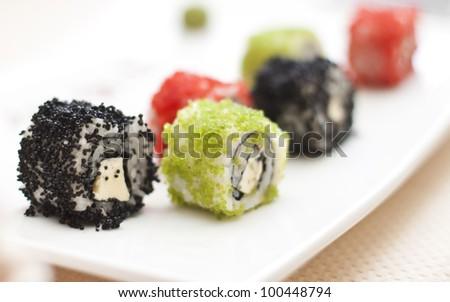 sushi and rolls (shallow dof) - stock photo