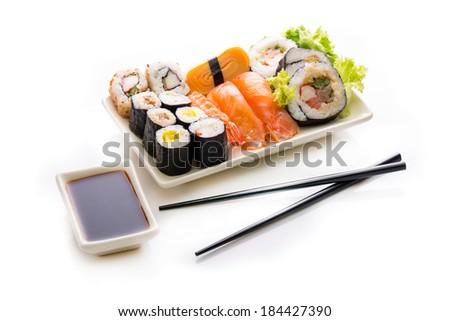 Sushi assortment isolated on white background. - stock photo