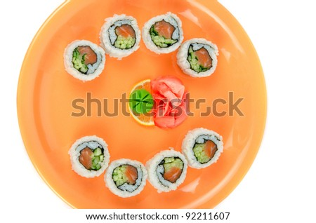 sushi at orange plate isolated on a white background