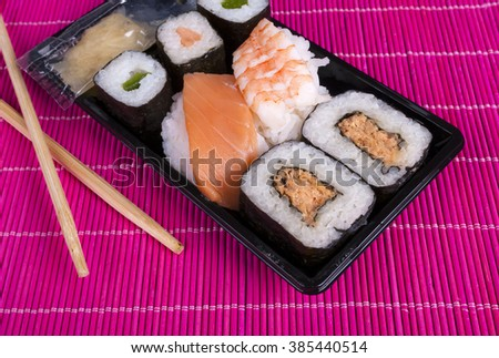 sushi box with assorted sushi pieces - stock photo