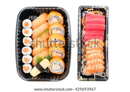 Sushi box with roll fresh salmon sushi , raw fresh salmon meat sushi rice , California roll maki , and Sushi sweet egg in black box isolated on white background - Japanese food style