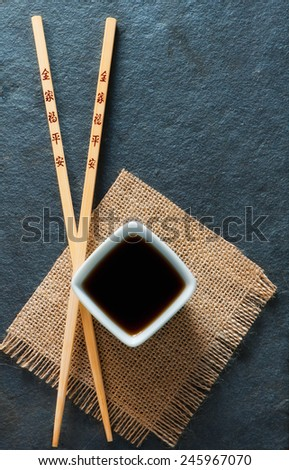 Sushi chopsticks and soy sauce bowl - stock photo