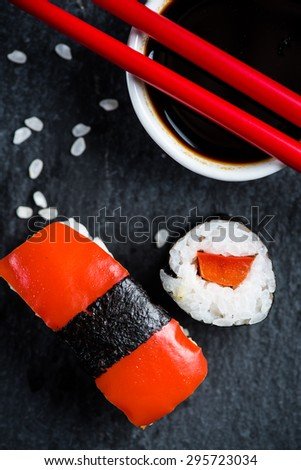 Sushi, chopsticks and wasabi, on black slate from above - stock photo