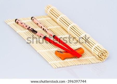sushi chopsticks sauce on white background, isolated - stock photo