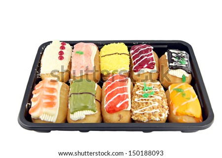 Sushi color Donuts in the black dish on white background.