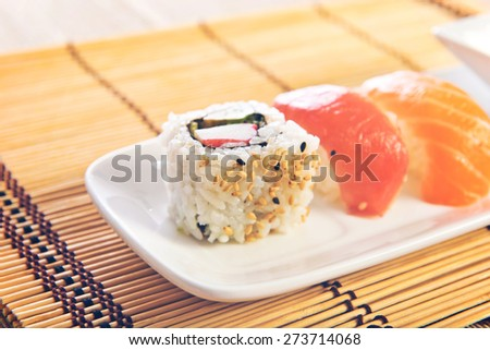 Sushi food over wooden background - stock photo