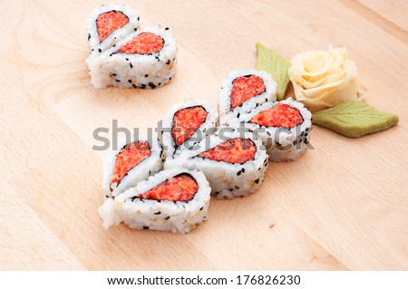 Sushi forming hearts and flower shapes - stock photo