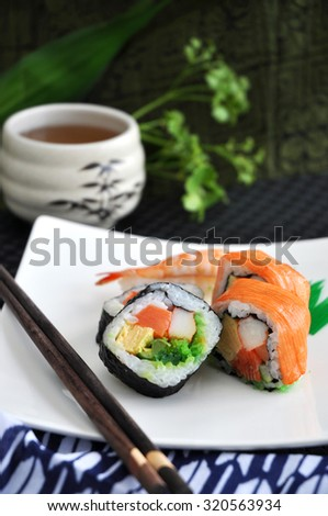 sushi japanese food with tea cup on background