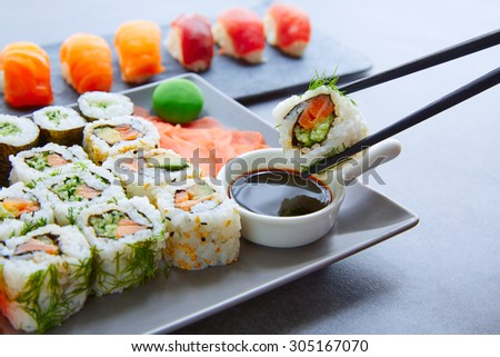 Sushi Maki and Niguiri with soy sauce and wasabi with California Roll - stock photo