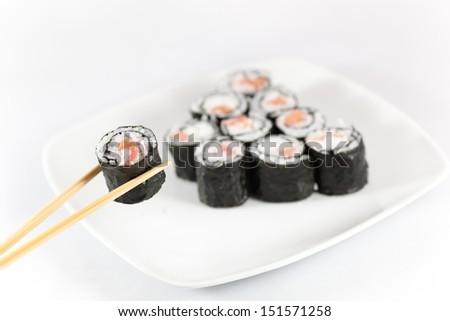 Sushi menu and chopsticks - stock photo