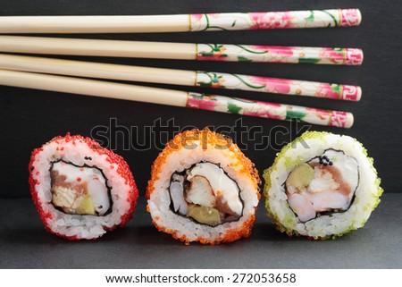 Sushi on a background of Japanese chopsticks - stock photo