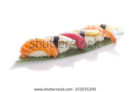 Sushi on a bamboo list over white background - stock photo