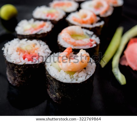 Sushi on a black plate. Restaurant