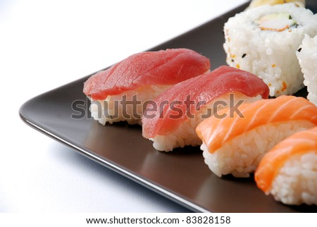 sushi on a brown dish - stock photo