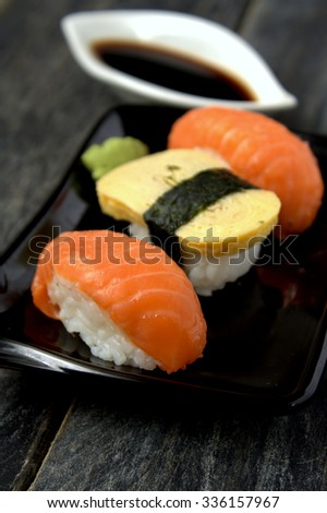 Sushi on black plate and black background