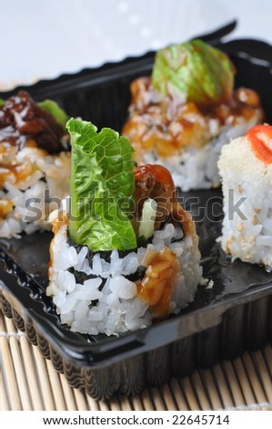 Sushi on black tray