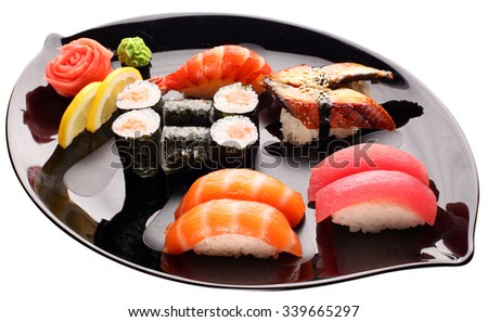 Sushi on the black plate. Traditional japanese food. File contains clipping paths.