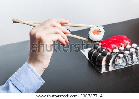 Sushi on the table. A delicious breakfast for us young people. East cuisine appetizing and useful.