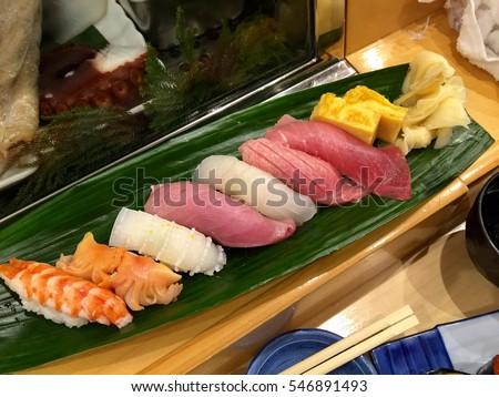 Sushi plate Tokyo cafe. Sushi restaurant. Sushi cafe Tokyo Japan. Japan fish delicacy. Fish food susi Nigirizushi. Seafood meal. Japan seafood sashimi. Seafood salmon fish lunch.Sushi background Japan