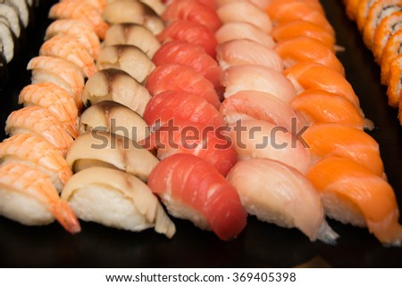 Sushi platter with a mixed variety of the Japanese delicacy at a buffet spread table. - stock photo