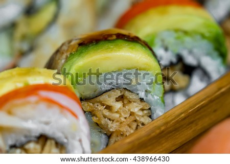 sushi platter with a variety of rolls in all colors and flavors - stock photo