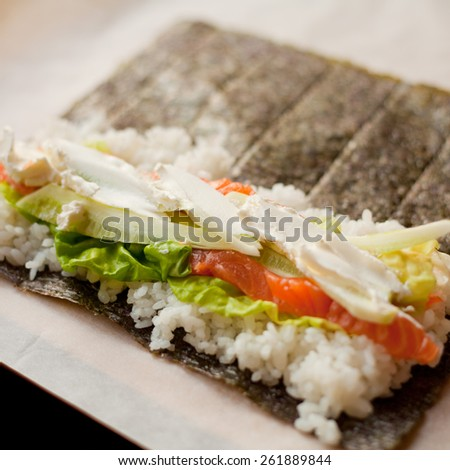 Sushi prepared with rice, raw tuna, raw salmon, wasabi sauce, majo, soya sauce, prawn and avocado. You can find it at japanese restaurant. Japan, japanese food, Asia - stock photo
