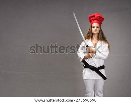 sushi restaurant girl ready for work, gray background - stock photo