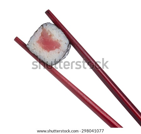 Sushi roll in chopsticks isolated on white background