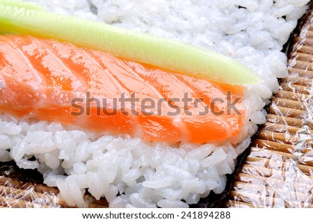 sushi roll preparing - stock photo