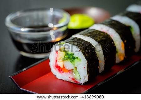 Sushi Roll Set in Japanese dish with shoyu Sauce - stock photo