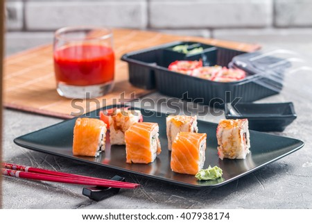 Sushi roll : Set of salmon & eel sushi rolls on plate with chopsticks - stock photo