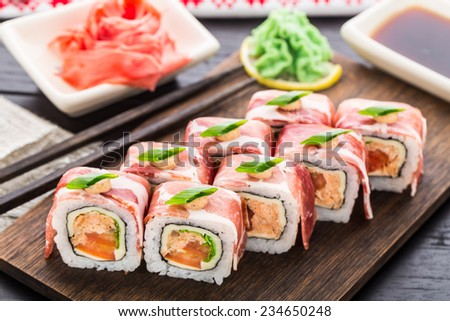 Sushi roll with bacon - stock photo