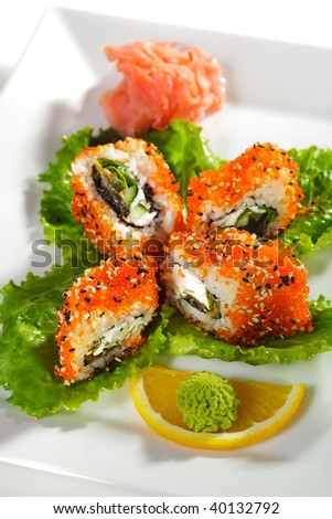 Sushi Roll with Eel, Fresh Cucumber, Salad Leaf and Cream Cheese inside. Tobiko (flying fish roe) and Sesame outside