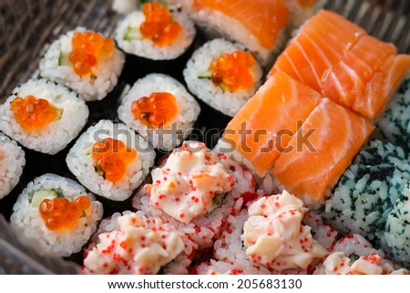Sushi roll with salmon and caviar fish