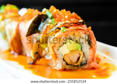 Sushi roll with salmon avocado and eel