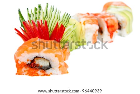 "Sushi Roll with salmon, eel, caviar, avocado, rice and tiger shrimp. ""Rainbow dragon"". Isolated on white"