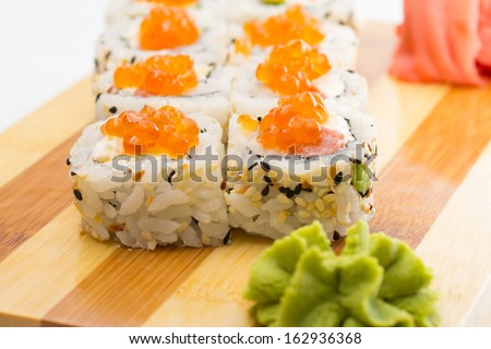 sushi roll with sesame and caviar