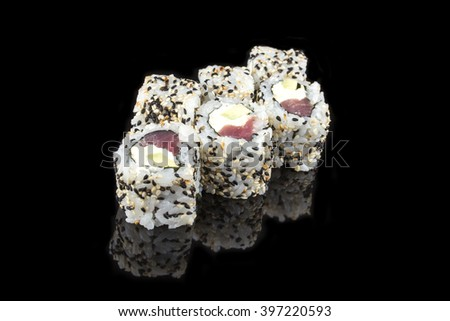 Sushi roll with tuna and cucumber on black background/Japanese food
