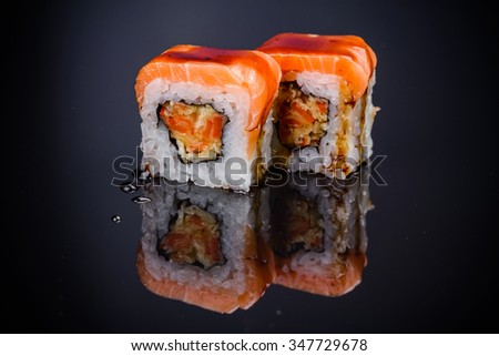 Sushi roll with with tempura and salmon