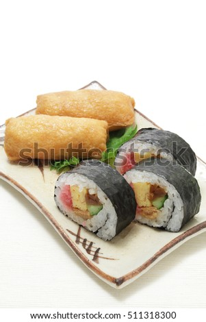 Sushi rolls and Fried bean curd stuffed with sushi rice